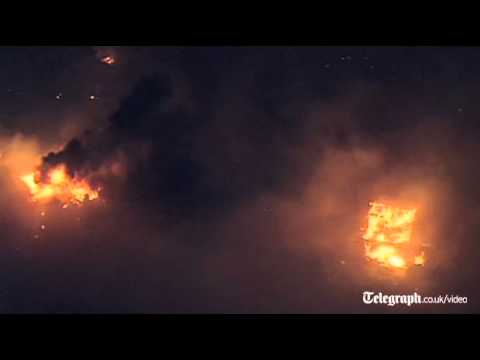 Dozens of homes destroyed in Texas wildfires
