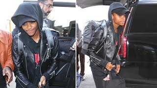 Tuesday, january 24, 2018 - black panther's letitia wright tries to fly under the radar in a hoodie and baseball cap, paired with motorcycle jacket, ...