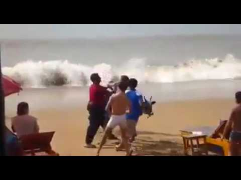 Foreign Tourists in Goa being beaten up by Hindu Fanatics for shooing away a Cow eating their food