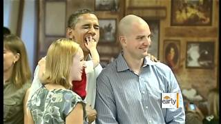 Baby puts hand in Obama's mouth