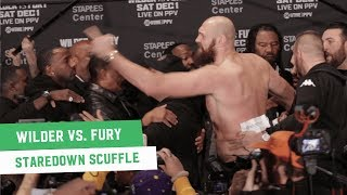 Tyson Fury and Deontay Wilder Get Physical at Final Press Conference Staredown