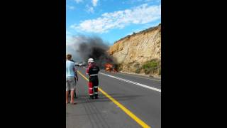 CAPE TOWN - Car found on fire after accident on coastal road - RAW