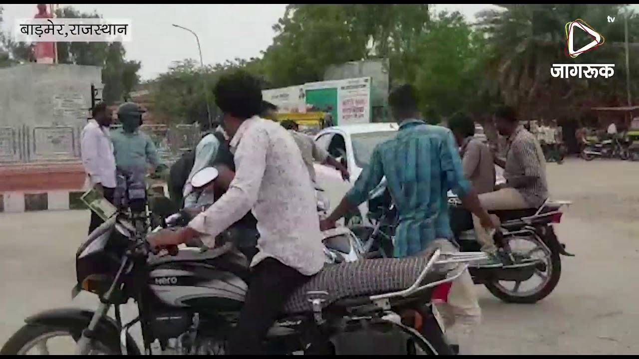 बाइक सवार को कार चालक ने बुरी तरह पीटा