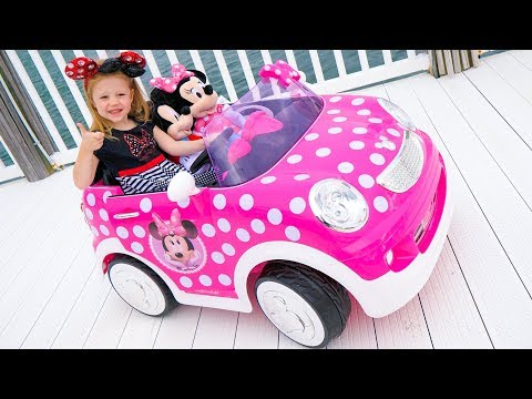 Stacy and the new children's car ride on with a minnie mouse
