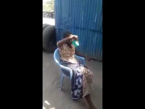 Awesome People: Kenyan Woman Does Flips With Water and Food.