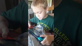 Gavyn gets a $50 Nintendo eshop card and buys Fortnite Vbucks