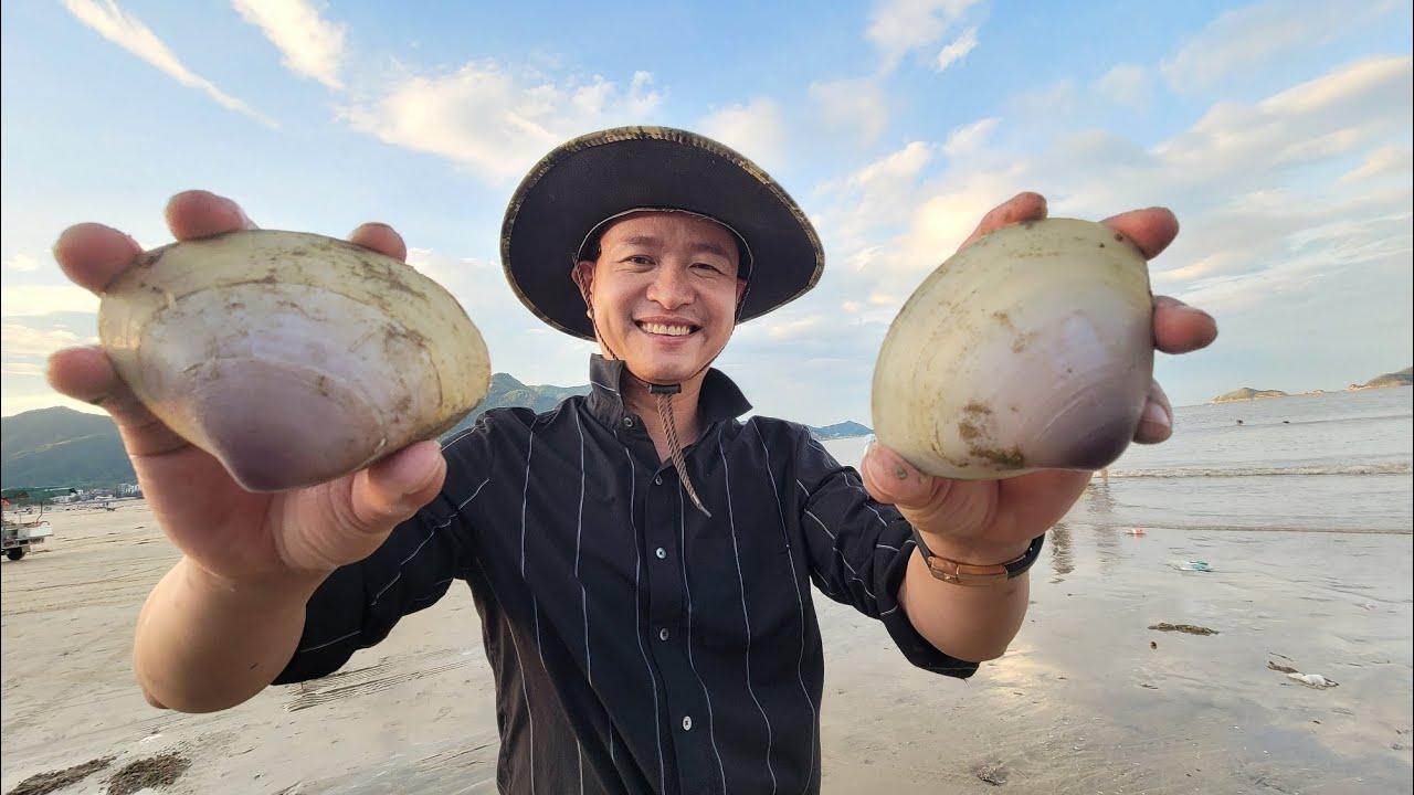 台风后海滩上发现拳头大的蛤蜊,一百块钱买了一大锅,大伙吃过瘾了