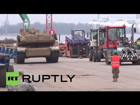 Watch LIVE as the American armoured vehicles stop in Riga on way to Germany