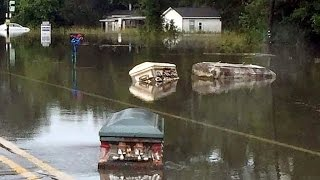 Eerie Coffins Seen Floating Through Flooded Louisiana Streets thumbnail