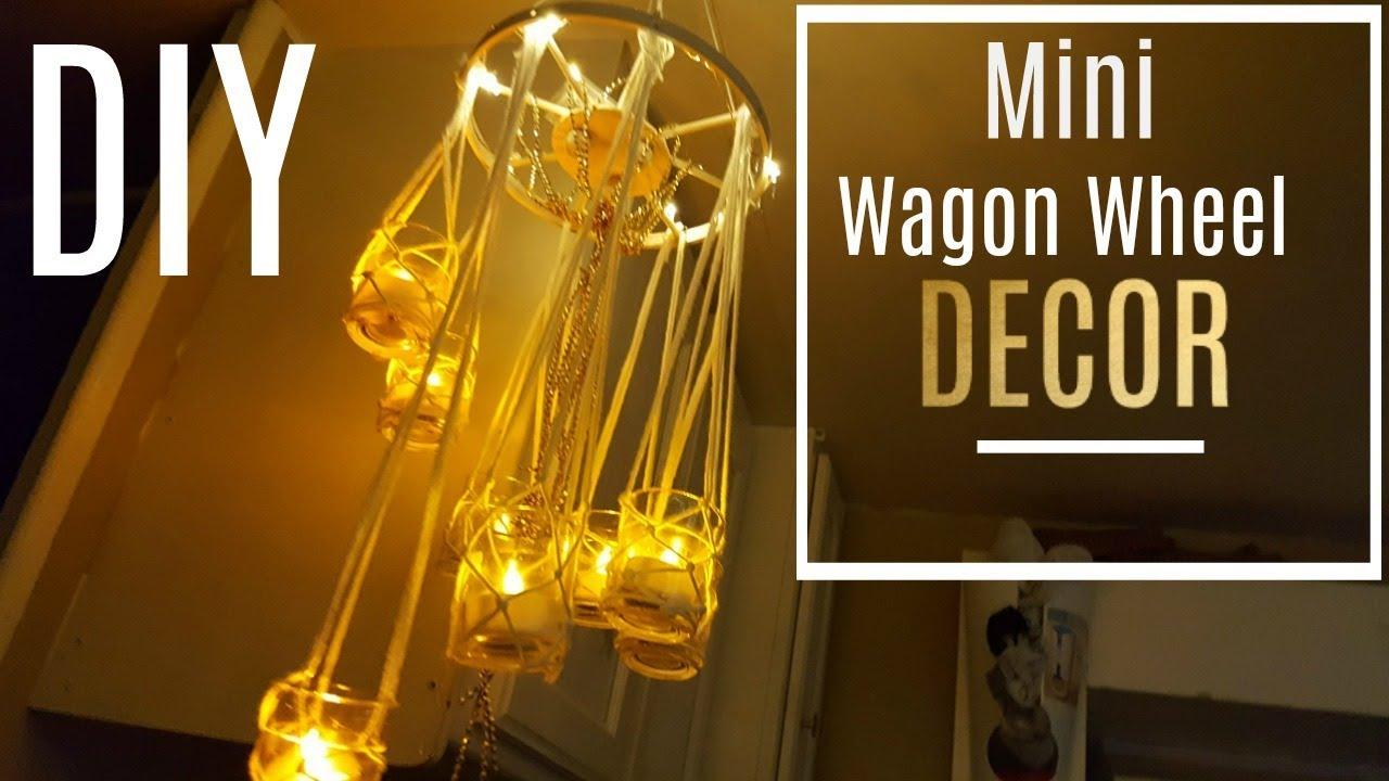 Diy mini wagon wheel chandelier made with dowels easy to make diy mini wagon wheel chandelier made with dowels easy to make arubaitofo Images