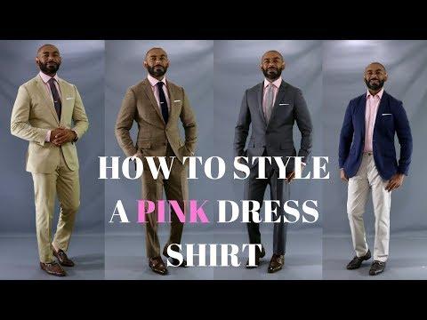 Pink shirt black pants tie