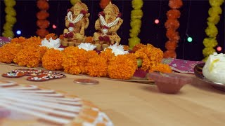 Pan shot of a small temple/mandir decorated for Diwali/Dipavali puja - Indian festival