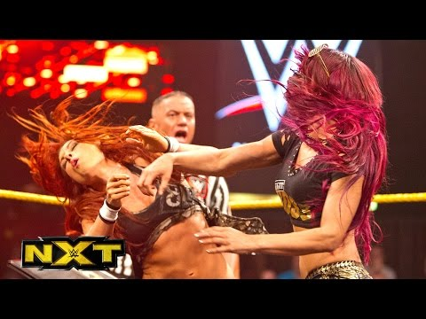 Sasha Banks and Becky Lynch sign the contract for their match at TakeOver: WWE NXT, May 6, 2015