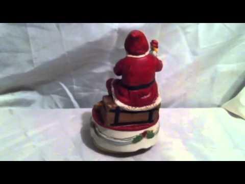 Santa music box plays silent night