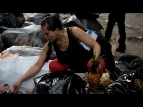 Venezuelans selling trash for cash