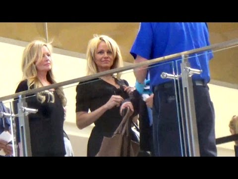 EXCLUSIVE - Pamela Anderson Is Lovely In Black At LAX thumbnail