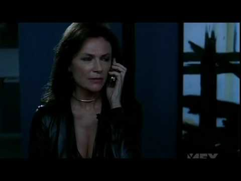Jacqueline Bisset black leather skirt suit from Niptuck4x093