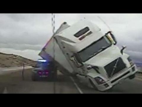 Semi-truck crushes cop cruiser