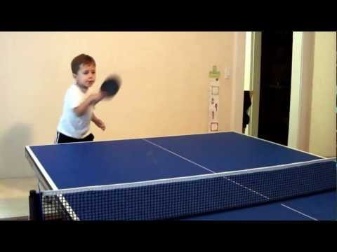 Polish Kid playing ping pong (table tennis)