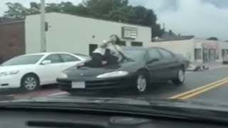 VIDEO: Road rage victim clings to hood of car