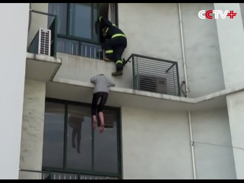Suicidal Woman Rescued from Shanghai Building