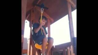 Cade rides the zipline