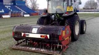 Verti drain in use on a frozen pitch