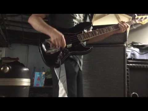 1969 Fender Jazz Bass and a 1977 Ampeg V-4B