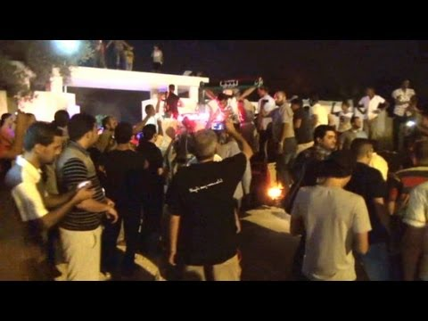 Libyan protesters force militias out