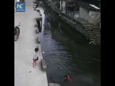 Girl falls into river, rescued by deliveryman passing by