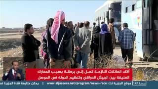 مئات العائلات تنزح من شرق الموصل إلى البرطلة