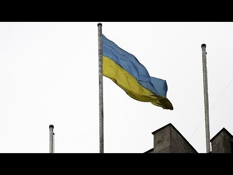 Ukraine raises flag over Donetsk building, as Crimea bases are surrounded