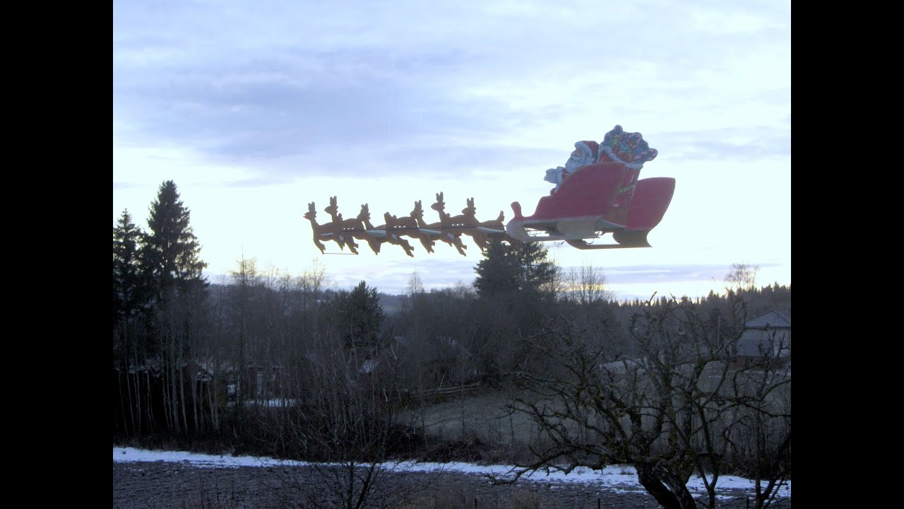 flying santa with his sled and reindeer