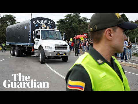 Aid trucks arrive at Venezuela border as Maduro tries to woo security forces