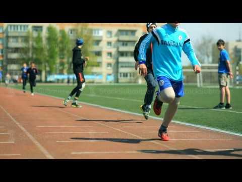 Russia, Novosibirsk, 2015: Students run around the stadium