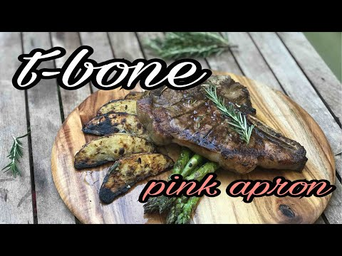 PINK APRON/ T-BONE STEAK garlic herb butter, charred potato and asparagus-