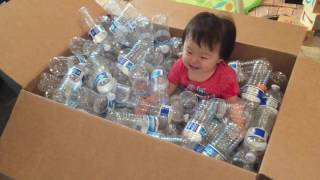 Baby plays in a DIY ballpit