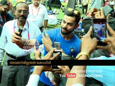 Virat Kohli giving instruction to ball boys in Bangalore Stadium