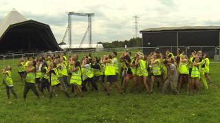 Glastonbury bin painters do the Dolly Mob dance