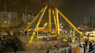 One girl killed, at least 11 injured as a swing collapses in Pakistani amusement park