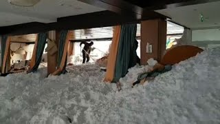Austrian army helps after an avalanche damages a hotel
