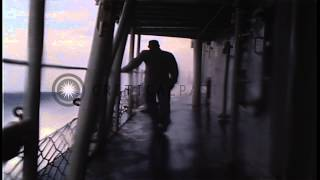 Sea washes over a United States Navy destroyer in Pacific Ocean due to heavy stor...HD Stock Footage