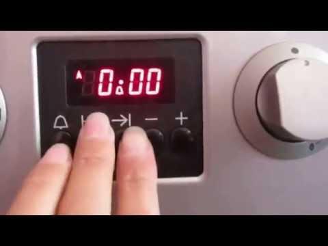 Инструкция как легко настроить электронные часы в плите hansa.