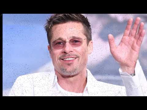 Brad Pitt does his best to bring back the all-white ensemble at War Machine premiere in Tokyo