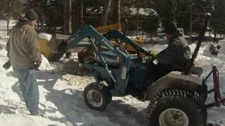 Fixing track on a John deere 2010 crawler loader