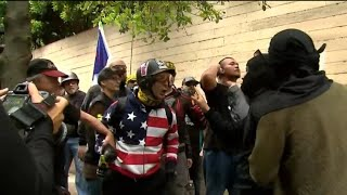 Police arrest 4 during violent clashes between dueling protesters in Portland