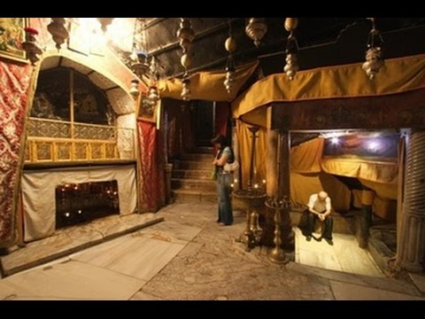 Praying at Jesus' birthplace. Church of the Nativity, Bethlehem. Tour Guide: Adel Dweib