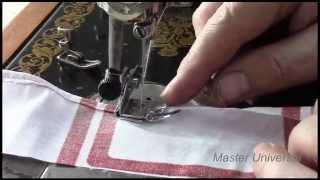 Подольская швейная машина. Заправка верхней нити и разные лапки. Видео №53.