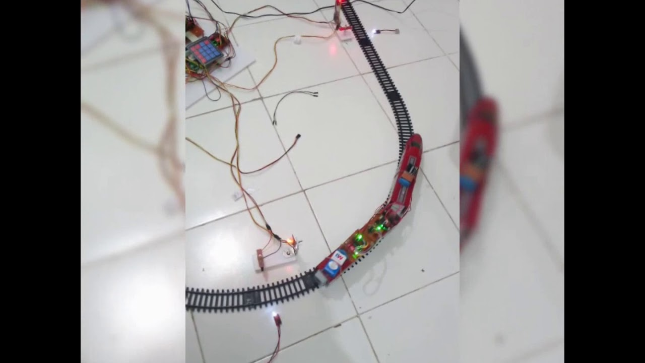 Download AUTOMATIC RAILWAY TRAIN MANAGEMENT SYSTEM USING GSM AND RF MODULE