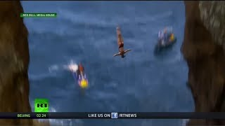 Cliff diving duo tackles tough jumps in Portugal
